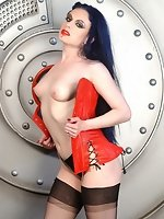 sweet brunette girl Darenzia stripping red leather corset in the...