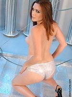 hot brunette model Aimee Sweet stripping posing and teasing