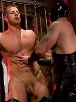 Dak Ramsey whips and fucks studly Mitch Colby in heavy bondage