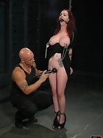 On her knees with her breasts bound, Berlin is blindfolded and...