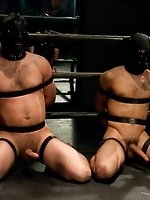 Brenn Wyson ties up two stud in leather hoods and fucks the cum out...