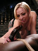 Seven in an interracial domination scene with slave boy