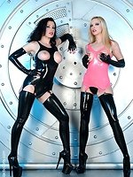 lesbian babes Emily and Anastasia posing in sexy leather and...