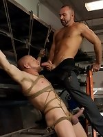 Josh West ties up and fucks Luke Riley and Kain Warn in the metal shop