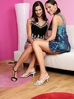 Gorgeous brunettes undress and strapon bang quims on sofa