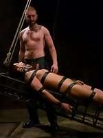 Geoffrey Paine fucks and sucks two ripped studs in bondage