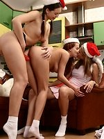 Three Santa cuties kiss and bang pussies in strapon romp