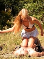 Femdom session on a meadow