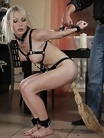 Sexy blonde lady wrapped in fetish gears is punished by the master