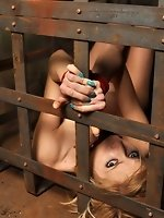 Slave Dolly bound up in a lattice crate